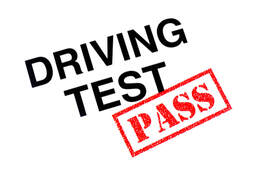 Picture of a Driving Test heading stamped with a red Pass